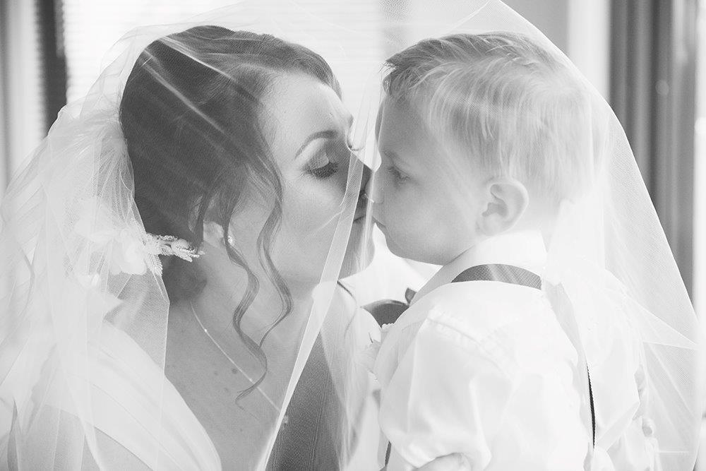 bride-kissing-son